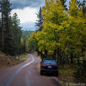 My old Pathfinder sits on the side of Rampart Range Road on a scenic drive I took on my birthday last year. Pikes Peak can just be seen through the fog and mist of an autumn storm that rolled in near the end of the drive between Sedalia and Woodland Park.