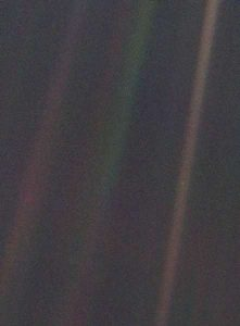 A photo of Earth taken from 3.7 billion miles away.